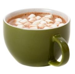 Green mug of hot cocoa with marshmallows on top.