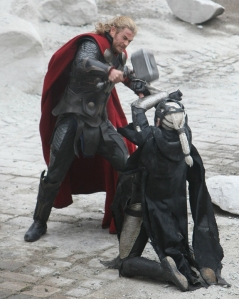 Thor-dark-world-chris-hemsworth-hitting-christopher-eccleston-malekith